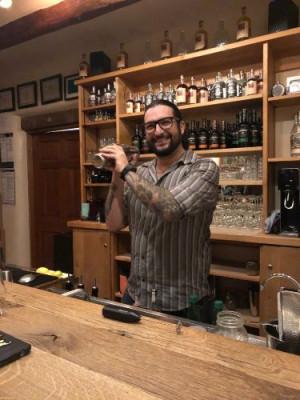 Angelo behind bar